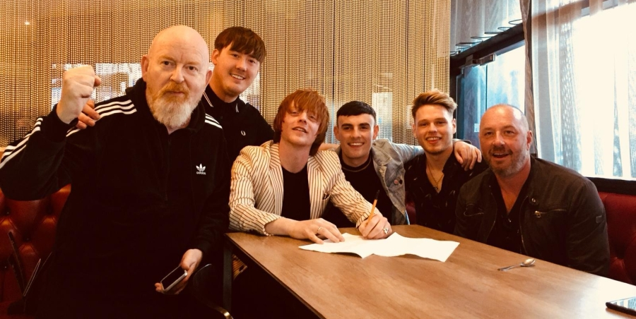 Signing with Creation 23 label owners Alan Mcgee and Simon Fletcher back in April.